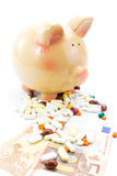 Piggy bank with pile of pills and banknotes Royalty Free Stock Photo