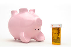 Piggy Bank and Pill Bottle Isolated on White Royalty Free Stock Photos