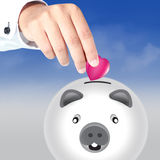 Piggy Bank and pink Heart Stock Photography