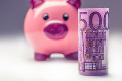 Piggy bank.Pink Piggy save and Five hundred Euro banknotes.Toned photo Stock Photos
