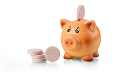 Piggy bank with pink tablet on the back Stock Images