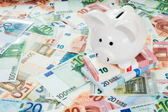 Piggy bank placed on Euro banknotes Royalty Free Stock Image