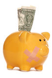 Piggy bank with plaster and one dollar bill Stock Photo