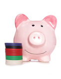 Piggy bank with poker chips Royalty Free Stock Photos