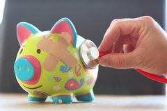 Piggy bank poor health Royalty Free Stock Photo