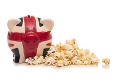 Piggy bank and popcorn Royalty Free Stock Image