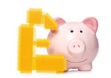 Piggy bank with pound sign cut out Royalty Free Stock Photos