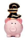 Piggy bank with pound sign cutout Royalty Free Stock Photos