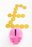 Piggy bank and pound sterling sign Royalty Free Stock Photos