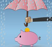 Piggy bank protected from rain. Protection, insurance. Royalty Free Stock Photos