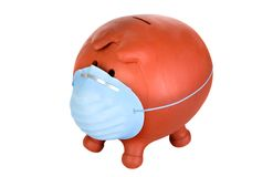 Piggy bank with protective mask Stock Image