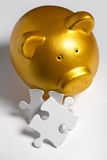 Piggy bank and Puzzle. Business concept of Solution Stock Image