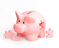 Piggy bank and puzzles Royalty Free Stock Image