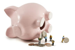 Piggy bank raid Stock Images