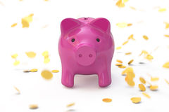 Piggy bank and a rain of coins Royalty Free Stock Photography