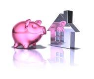 Piggy bank real estate Stock Photos