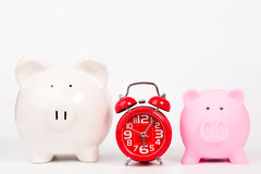 Piggy bank and red alarm clock Royalty Free Stock Images