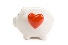 Piggy Bank and Red Heart Royalty Free Stock Image