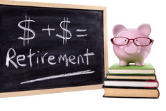 Retirement plan, Piggybank with pension fund growth calculation isolated on white background. Pink piggy bank with glasses standing on old textbooks next to a Royalty Free Stock Images