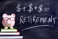 Retirement plan planning piggy bank pension fund. Pink piggy bank with glasses standing on books next to a blackboard with simple retirement formula.  Sharp Royalty Free Stock Image