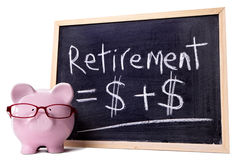 Piggy Bank with retirement growth plan formula isolated on white background Royalty Free Stock Photography