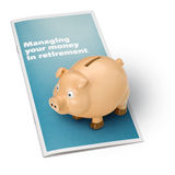Piggy Bank Retirement Savings. A piggybank on a money management bank brochure isolated on white Royalty Free Stock Photo