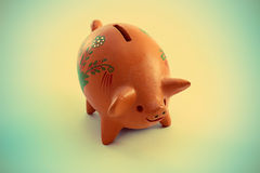 Piggy bank with a retro vintage effect Royalty Free Stock Images