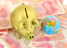 Piggy bank and rmb bill Stock Image