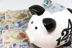 Piggy bank and romanian currency lei ron savings for pension retirement concept Stock Images