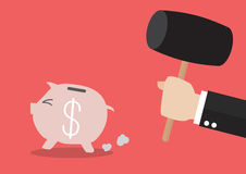 Piggy bank running from the hammer Stock Image