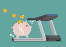 Piggy bank running on a treadmill Royalty Free Stock Photos