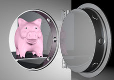 Piggy bank into a safe Royalty Free Stock Photo