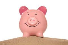 Piggy bank on sand Royalty Free Stock Photo