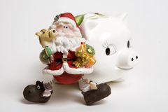 Piggy bank with santa claus Stock Photo