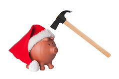 Piggy bank with Santa Claus hat and hammer Stock Photo