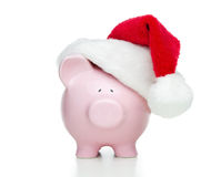 Piggy bank with santa hat Stock Images