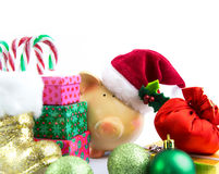 Piggy bank Santa with ornaments isolated Royalty Free Stock Images