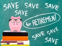 Piggy bank and save for retirement message Stock Image