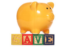 Piggy bank with save text Royalty Free Stock Images