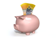 Piggy Bank Saving Australian Dollars. A pink ceramic piggy bank on an isolated white background with a wad of australian dollar notes stuffed into its slot Stock Photos