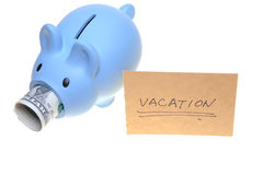 Piggy bank saving for vacation Royalty Free Stock Photos