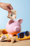 Piggy bank saving for vacation or retirement Royalty Free Stock Photos