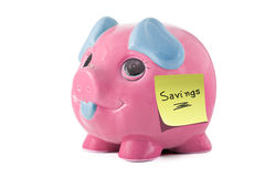 Piggy bank savings. Pink piggybank with sticky note that says savings Royalty Free Stock Images