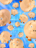Piggy Bank Savings Background. Many piggy banks in free fall on a blue background Stock Photos