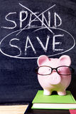 Savings plan - Piggy Bank with spend and save message Royalty Free Stock Photos