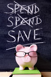 Savings plan - Piggy Bank with spending and saving message Royalty Free Stock Photography