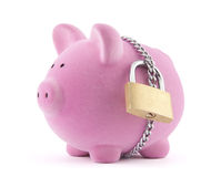 Piggy bank secured with padlock Stock Photo