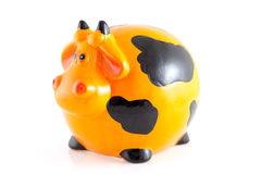 Piggy bank in the shape of orange cow Stock Image