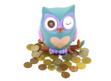 A piggy bank in the shape of a winking owl Stock Photo