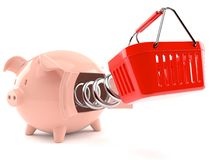 Piggy bank with shopping basket Stock Images
